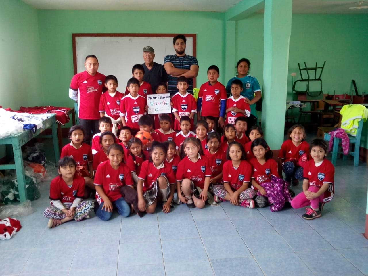 A donation of sports shirts to Manos Amigas